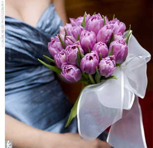 Janes bridesmaids carried bouquets of lavender tulips.