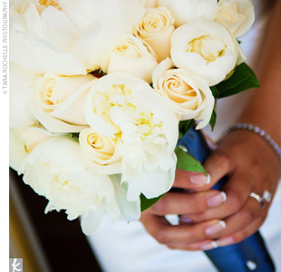 Annie carried a bouquet of white, ivory, and blush peonies wrapped in a dark satin ribbon to match the sash on her gown.