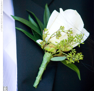 Jesse wore a single white rose on his lapel.