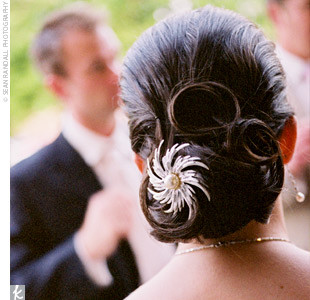Jennie wore her hair back in a low chignon and accessorized with a silver and pearl brooch.