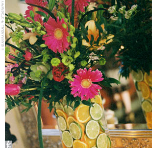 Jennie and Dave&#39;s wedding colors splashed into their vibrant blooms in the ceremony and reception decor!