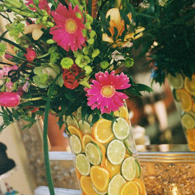 Jennie and Dave's wedding colors splashed into their vibrant blooms in the ceremony and reception decor!