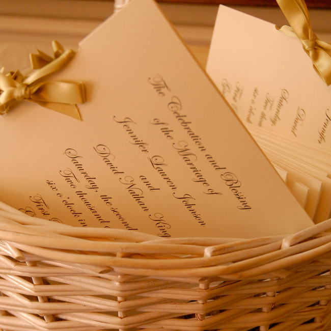 The formal scripted programs were tied together with a buttery colored silk ribbon.