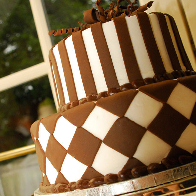 The whimsical groom's cake was a two-tiered, fondant-covered brown and white confection.