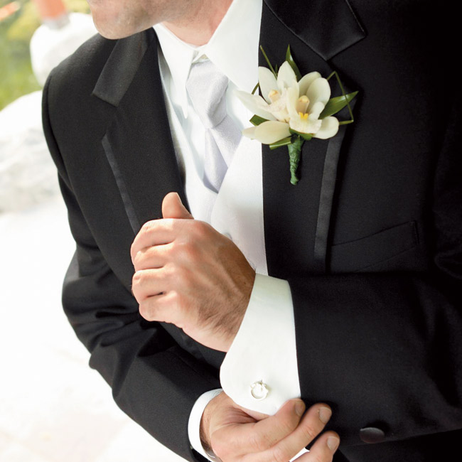 For a cultural touch, Andrew accessorized his tuxedo with silver claddagh cuff links that were made in Ireland. His boutonniere teamed cymbidium orchids with bear grass.