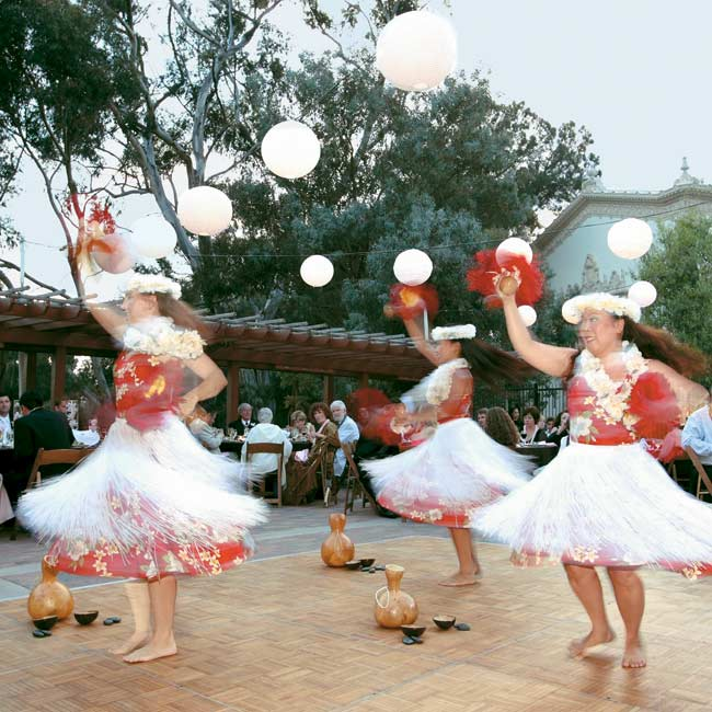Hawaiian dancers and drummers created the background music during the meal (filet mignon forestiere or miso-glazed salmon). As a surprise, the flower girl performed a hula dance she had learned especially for the occasion.
