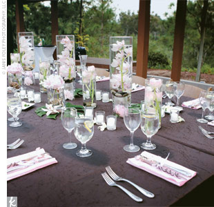 Chocolate-colored, crinkled satin linens and pink shantung napkins added a splash of color, while Japanese paper lanterns and candles added ambient light.
