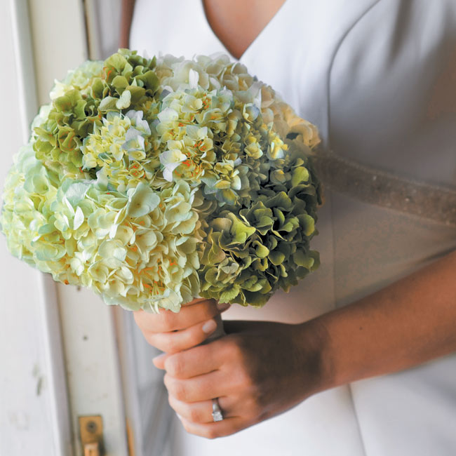 Kathleen's bouquet was a mix of green, white, and blue hydrangeas.