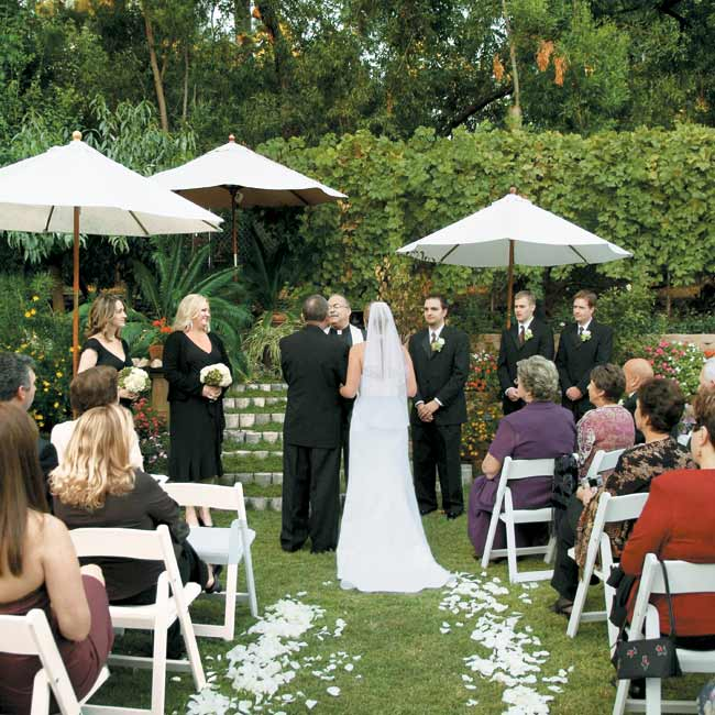 Chocolate brown and celery green complemented their outdoor nuptials, which were held on the grounds of a family friend's Craftsman-style home. Kathleen and Alexander exchanged vows in an intimate, short ceremony in the backyard, where the fruit trees, grapevines, and flowers provided natural decor.