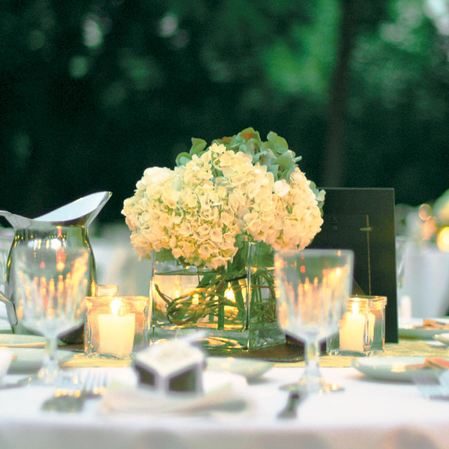 Kathleen and Alexander's centerpieces were square vases filled with green hydrangeas. Square votives completed the look.
