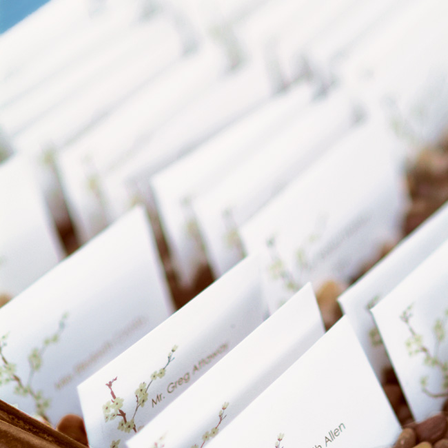 The simple white escort cards were printed with a cherry blossom motif, which was carried over from the wedding invitations.