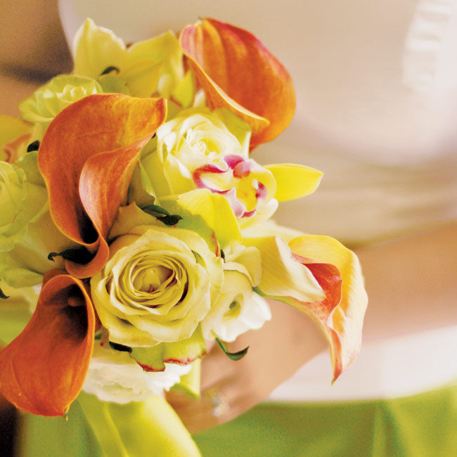 Cheryl's attendants carried mango calla lilies, cymbidium orchids, and lime green roses to match their A-line dresses with ivory bodices and kiwi-colored skirts.