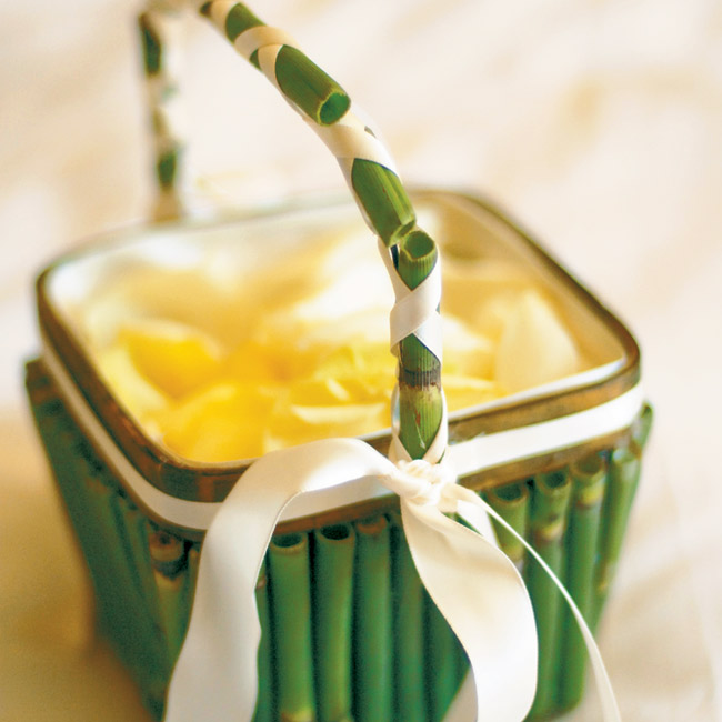 Each flower girl carried a horsetail bamboo-covered basket filled with a mix of lime and orange rose petals.