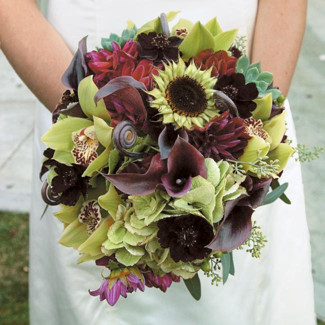 Julie's bouquet was made up of deep burgundy calla lilies and dahlias, antique hydrangea, seeded eucalyptus, green coffee beans, chocolate cosmos, cymbidium orchids, and sunflowers.