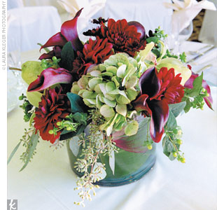 Low, lush arrangements of flowers similar to those found at the ceremony decorated some of the tables.
