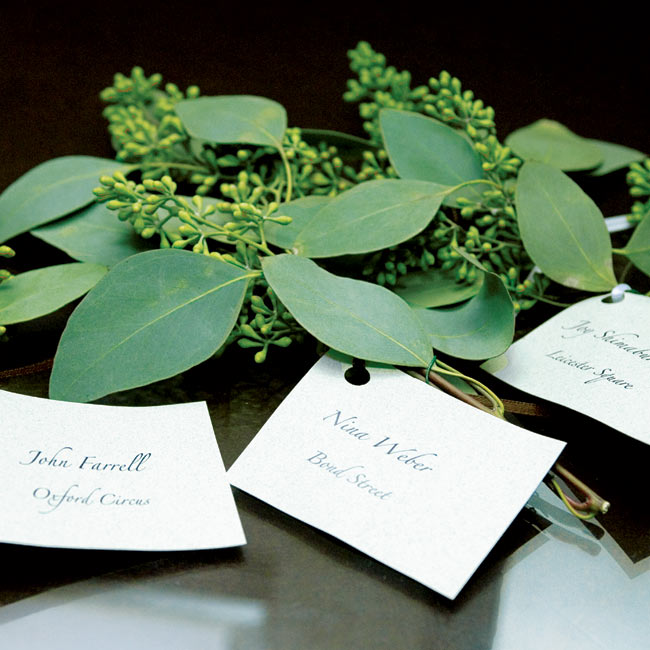 Guests found their tables using escort cards, which were attached to leafy branches.