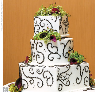 After dinner, the couple sliced into their wedding cake, a three-tiered chocolate, hazelnut, and lemon with raspberry confection.