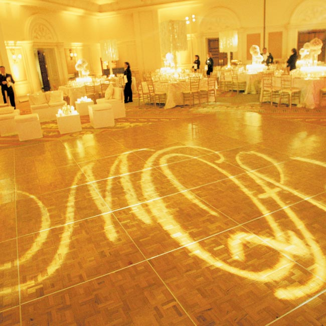 The newlyweds' initials could be found everywhere, from the icy vodka luge during the cocktail hour to the gobo lighting on the dance floor and the personalized cigar bands.