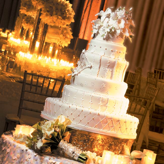 The elegant six-tiered, off-white cake featured a different design on each tier. The vanilla and almond–flavored confection was covered in fondant and topped with sugar orchids.