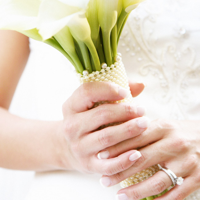 Ann carried a bouquet of white mini calla lilies with a pearl wrap around the stems.