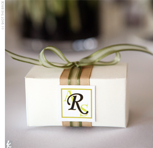 The mother of the bride created Ann and Steve's favors. At each place setting, guests found small boxes of chocolates sealed with ribbons in the wedding colors and a sticker with the bride and groom's monogram.