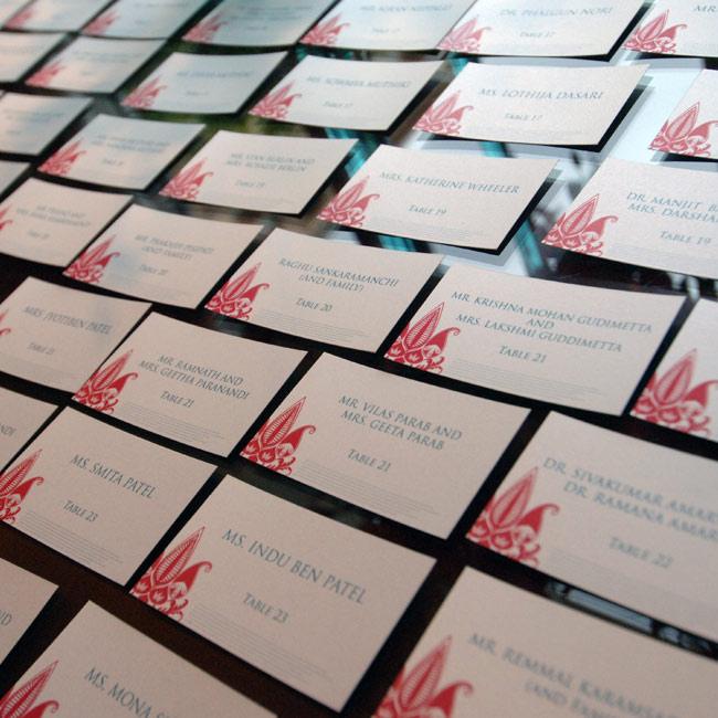 Joy and Sateesh's escort cards were created to mirror the filigree design used on their invitations, also incorporated into the centerpieces and the cake.