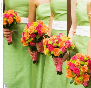 Katherine's bridesmaids carried a smaller version of the bride's bouquet, wrapped in pink silk ribbons. The maids wore strapless, apple green, cocktail dresses and accessorized with pearl bracelets, a gift from the bride.