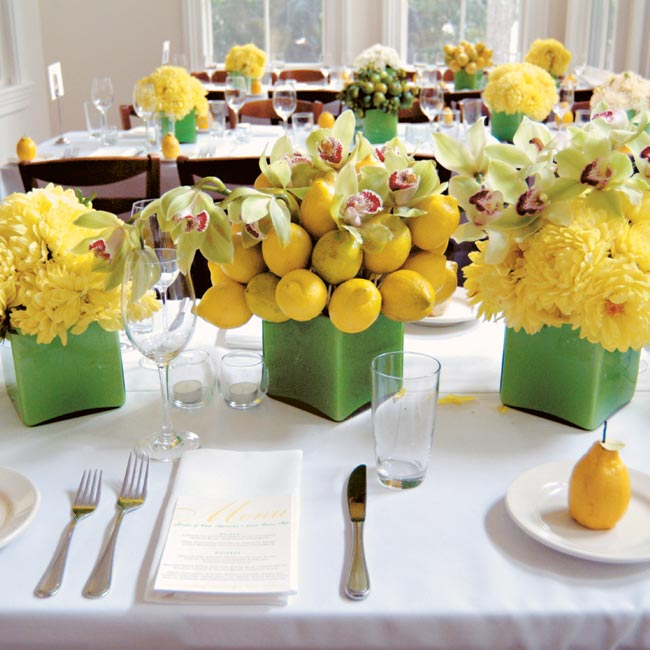 Each table was lined with unique, square vases filled with lemons, limes, orchids, and cottage roses.