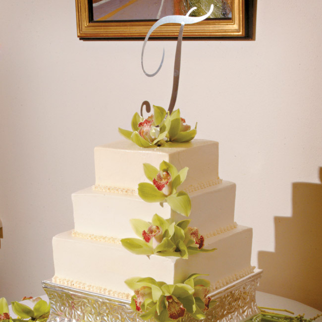 The couple served two cakes for dessert: First was a vanilla bean cake with lemon curd and fresh raspberry filling, iced with vanilla bean buttercream, and the groom's cake was a classic yellow cake with chocolate ganache filling and frosting.