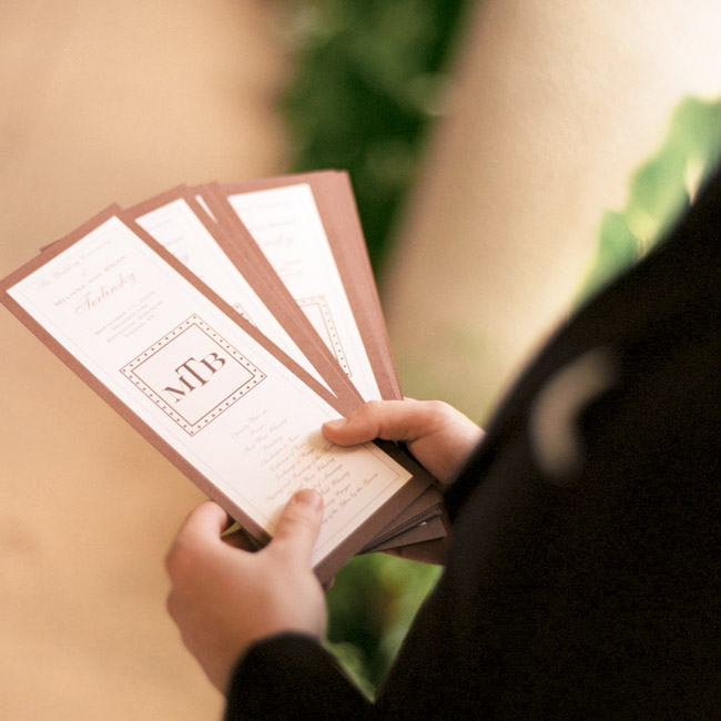 The mother of the bride created the programs, which incorporated the couple's monogram logo.
