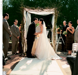 "Melissa and Brian married on the terrace of The Atrium at Meadowlark Botanical Gardens. The couple exchanged vows they'd written themselves beneath a huppah covered in natural-colored dupioni silk and draped with curly willow and moss. ""We sat down and discussed what we felt were the important factors in keeping a marriage strong and healthy,"" Meli ..."