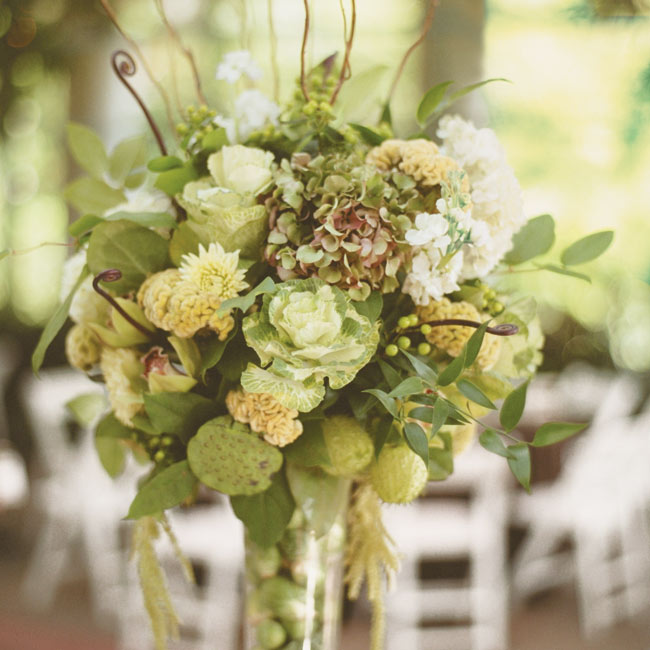 Some tables had tall arrangements of glass vases filled with Brussels sprouts and cabbage leaves that were topped off by lush blooms, including hydrangeas, orchids, dahlias, ferns, and pods. Other tables featured long, low centerpieces of orchids, bells of Ireland, celosia, dahlias, and artichokes.