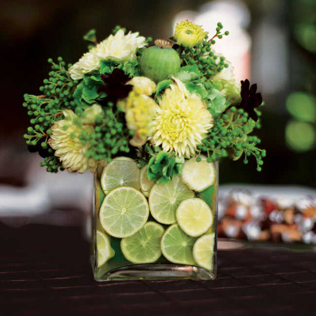 The third centerpiece was a square vase filled with lime slices and an arrangement of hydrangeas, cosmos, celosia, and dahlias, accented with berzillia and poppy pods.