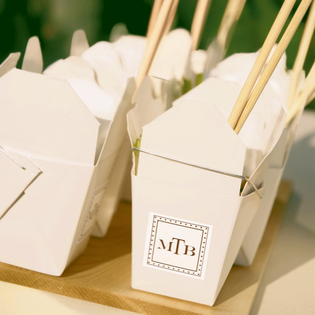 In keeping with the theme, Chinese take-out boxes filled with spicy beef lo mein were emblazoned with the couple's monogram.
