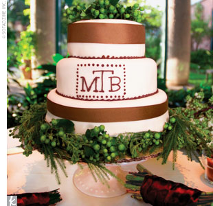 Melissa and Brian cut a small, three-tiered cake covered in ivory fondant and decorated with brown ribbon and polka dots. The cake was mostly for show, however, the real desserts were individual cheesecakes topped off with little flags bearing the couples monogram.