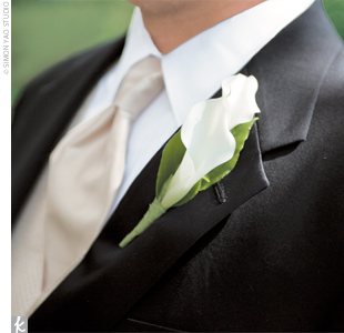 Simple white lilies popped against the black lapels of the groomsmen tuxedos.
