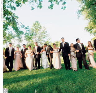 The six bridesmaids wore sophisticated A-line dresses by Bill Levkoff. The taupe-colored frocks featured champagne sashes to tie in with the elegant color palette. The groomsmen coordinated their traditional black tuxedos with champagne-colored vests and ties to match the sashes on the bridesmaid dresses.