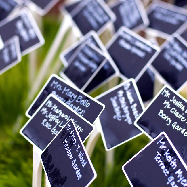 Courtney and Matt's guests found their seats via small, chalkboard plant stakes, which were displayed outside the reception tent on flats of wheatgrass.