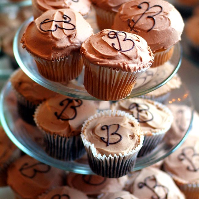 Instead of a traditional wedding cake, guests enjoyed mini cupcakes monogrammed with Bs. The cupcakes picked up the chocolate and mocha palette of the bridesmaid dresses.
