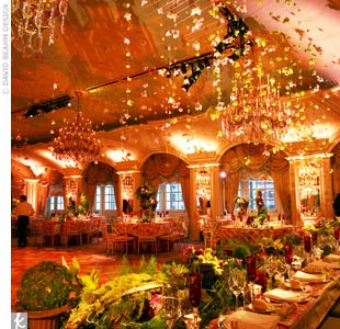 David and his design team love a challenge. When a bride requested a deconstructed, organic look for her formal, ballroom wedding, David hung celadon green orchids from the ceiling to draw guests' eyes upward. Amber and pink lighting flattered all in attendance. 
