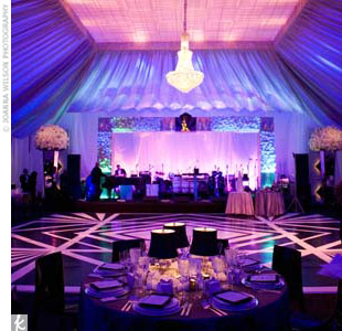 At a contemporary, nightclub-inspired reception, a black-and-white dance floor took center stage. To warm up the space, David created a floral arch to frame the live band. Also, the lighting changed throughout the evening, which induced even more wows from guests.