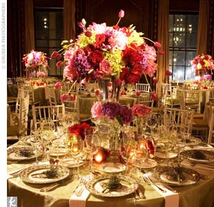 To contrast with the black-and-white ceremony decor, David created tall centerpieces bursting with pink, red, and yellow hydrangeas, roses, and tulips. Shorter vases were packed with monochromatic arrangements for a spring-like feel. 