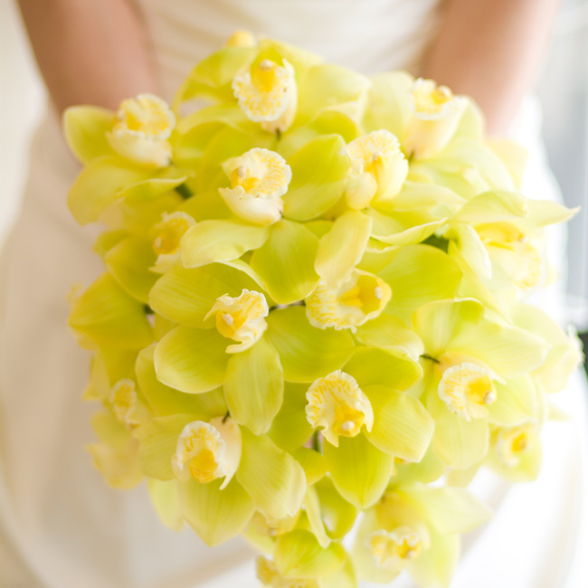 Rona carried a bright bouquet of light green orchids bound together with a piece of lace from her mother's wedding gown.