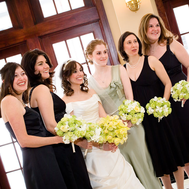 Rona's maids chose the fabric and style of their black tea-length dresses for a coordinated look. Clutches of green and white roses stood out against the bridesmaids' black dresses.