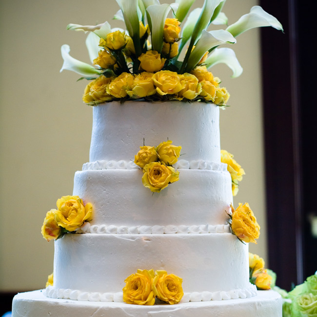 The couple's four-tiered vanilla cake was decorated with white and yellow calla lilies.