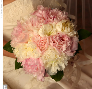 The bride carried a bouquet of pale pink and cream-colored peonies.