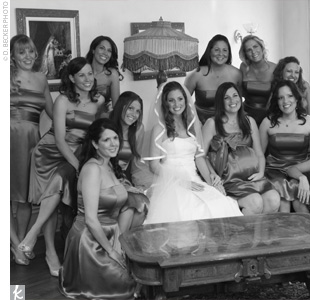 Meredith's 10 bridesmaids wore mocha-colored cocktail dresses with gold, open-toed heels.