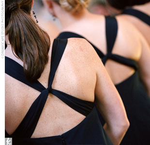 The five bridesmaids wore navy, silk, knee-length dresses that crisscrossed in the back. The dark-hued dresses nicely complemented the maids' bright pink bouquets.