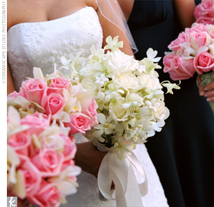 Each bridesmaid carried a pink and green bouquet down the aisle. The pink rose and green mini cymbidium orchid stems were wrapped with mint green, satin ribbon.