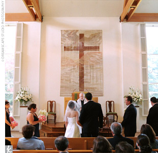 The ceremony took place in a large white church with floor-to-ceiling windows. The only floral arrangements Danielle and John used were two, large, white urns on either side of the altar filled with white and cream snapdragons, lilies, and roses with greenery.